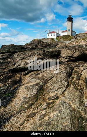 Beavertail Lighthouse is one of America's oldest lighthouses, sitting atop a scenic rock formation enjoyed by many - Stock Photo