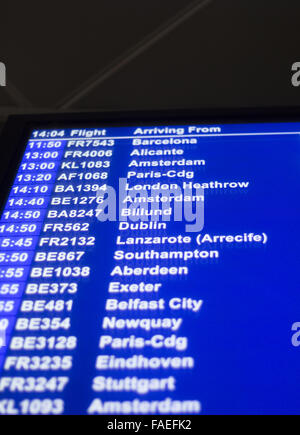 Airport departures arrivals board  light panel board giving information about flights in departure lounge. - Stock Photo