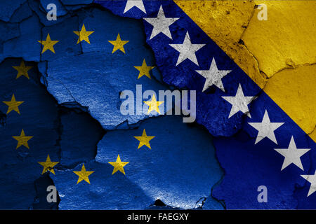 flags of EU and Bosnia and Herzegovina painted on cracked wall - Stock Photo