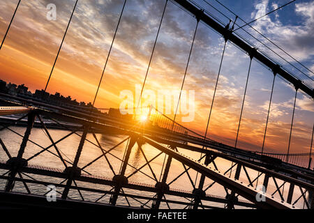 New York City, USA, early in the morning from the famous Brooklyn Bridge, view on Manhattan bridge - Stock Photo
