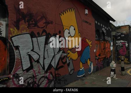 Grey clouds oblique Graffiti Life image Bart Simpson holding spray can, Pedley Street off Brick Lane, London, E1, - Stock Photo