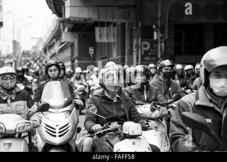 Taipei, Taiwan - December 2015 - Rush hour scooter traffic on a busy road in Taipei. - Stock Photo