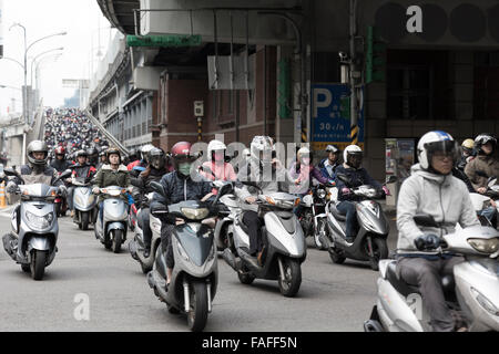 Taipei, Taiwan - December 2015 - Heavy rush-hour motorbike traffic in Taipei. - Stock Photo