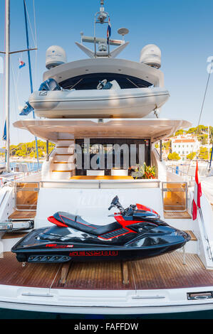 Stunning yacht with jet ski in the harbour at Hvar, Croatia, Split-Dalmatia ,Europe - Stock Photo
