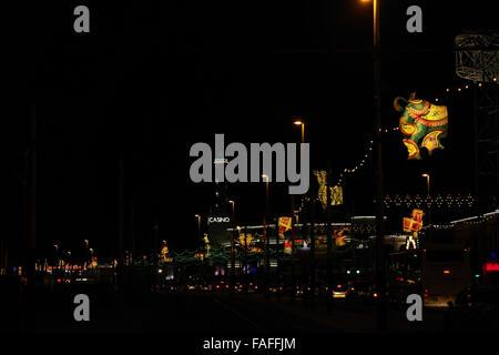 Night view Concertina Critters above promenade traffic to Nickelodeon images and Pleasure Beach Casino, Blackpool - Stock Photo