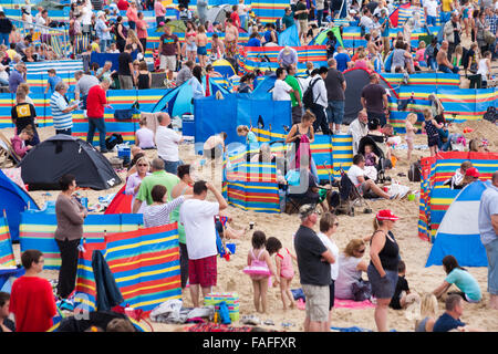 Thousands flock to Bournemouth beach for the Bournemouth Air Festival in August - Stock Photo