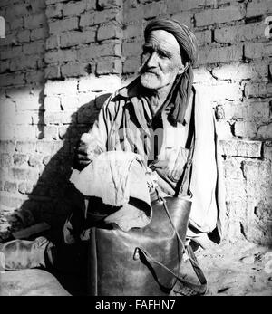 Ein Mann auf dem Basar in Samarkand in Usbekistan, Sowjetunion, 1970er Jahre. A man at the bazar of Samarkand in - Stock Photo