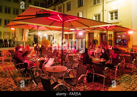 People sitting outdoors at a cafe at night, Place du Marche Gayot, Strasbourg Old Town, Alsace, France Europe (See - Stock Photo