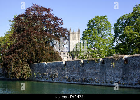 The 14th century moat surrounding the 13th century Bishops Palace in the cathedral city of Wells, Somerset UK - Stock Photo