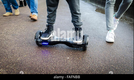 Person Riding a HoverBoard on a Public Footpath, They are now banned in all public places in the United Kingdom - Stock Photo