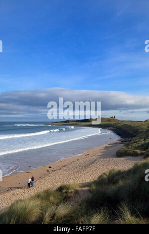Embleton Bay with Dunstanburgh Castle in the distance, Northumberland, England, UK - Stock Photo