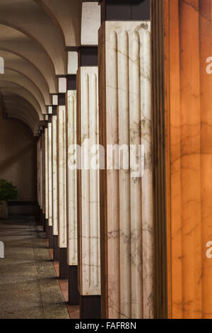 Square white marble columns in an arcade at the BC Provincial Museum - Stock Photo