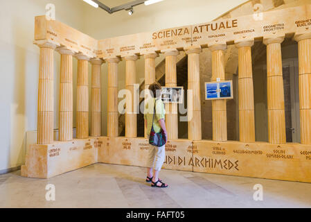 Woman museum, view of a woman visiting the 'Temple Hall' in the Arkimedeion, a museum dedicated to the inventions - Stock Photo