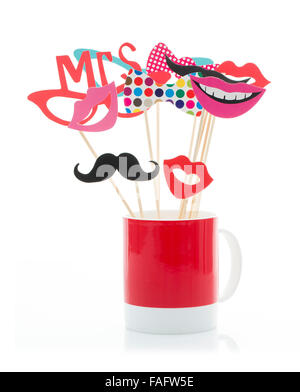 Photo Booth Props in a Red Mug on a White Background - Stock Photo