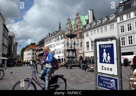 Pedestrian zone and cyclist in Amagertorv in the centre of Copenhagen, Denmark. - Stock Photo