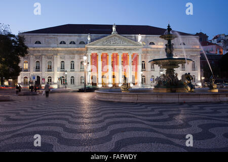Portugal, Lisbon, city center, Dona Maria II National Theater and Baroque fountain on Rossio Square at night - Stock Photo