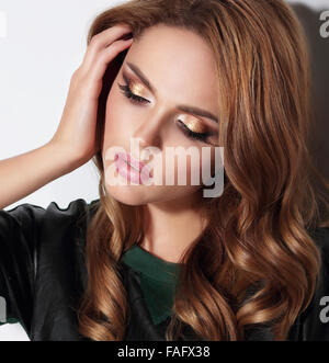 Close-up portrait with gold eyeshadows. - Stock Photo