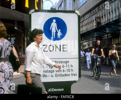 A 'Pedestrian Zone' sign at the beginning of a pedestrianised part of Minoritenstrasse in Cologne city centre, Germany - Stock Photo