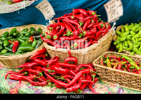 Baskets of red and green hot peppers on display at a farmer's market in Beaverton, Oregon, USA - Stock Photo