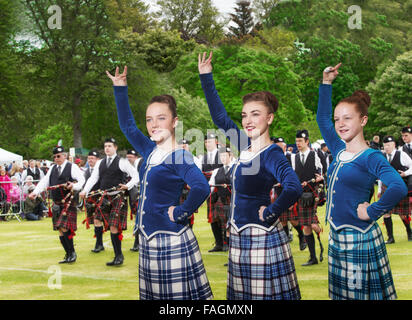 Highland dancers and a pipe band at the Highland Games in Aberdeen, Scotland, UK - Stock Photo