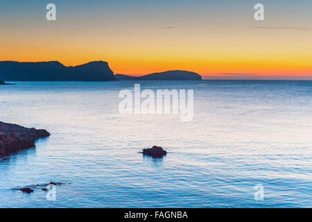 Sunrise over the calm beautiful water in Es Canar, Ibiza, part of the Balearic Islands in Spain,Europe. - Stock Photo