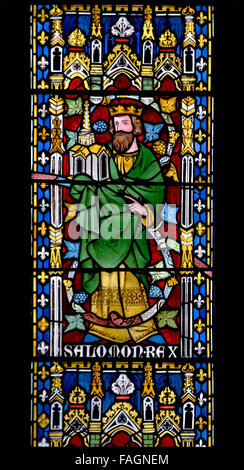 London, England, UK. All Saints Church, Margaret Street. Stained glass: west window (1877 by Alexander Gibbs) King - Stock Photo