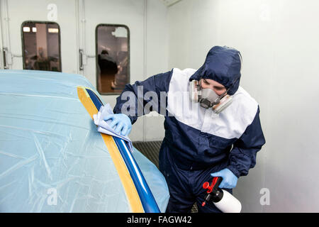 Vehicle varnisher cleans the places to be painted. - Stock Photo