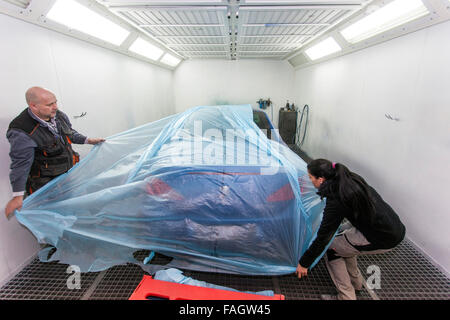 The vehicle is covered in front of the part paintwork. - Stock Photo