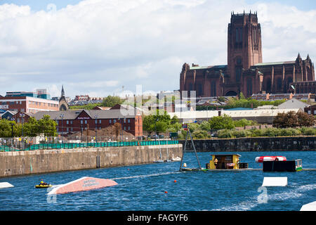 A wake boarding center and school in the Albert dock complex in the shadow of Liverpool's massive Anglican Cathedral. - Stock Photo