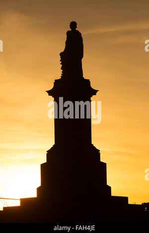 Silhouette of the memorial to Lord Collingwood at Tynemouth in Tyne and Wear, England. The memorial overlooks the - Stock Photo