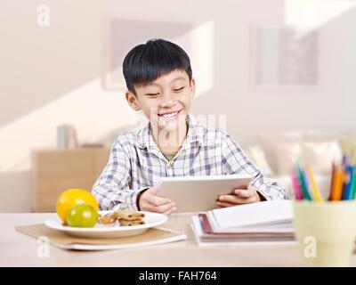 asian boy using tablet - Stock Photo