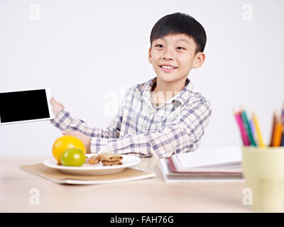 child showing his ipad - Stock Photo