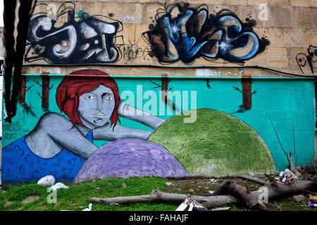 Street art in Baku, Azerbaijan. A public wall in a slightly scruffy area of Azerbaijan's capital city with contrasting - Stock Photo