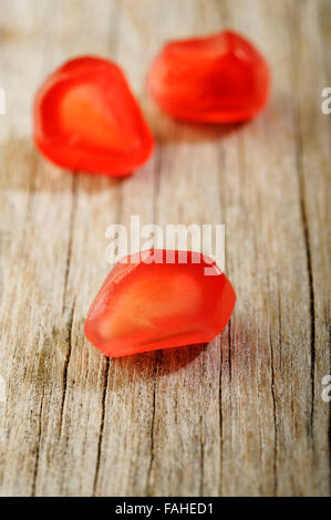 ripe pomegranate seeds on wooden table background - Stock Photo