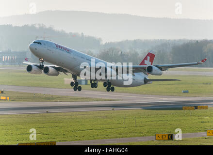 An Airbus A340 of Swiss International Air Lines during take-off from Zurich international airport. - Stock Photo