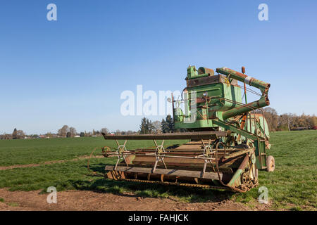 An antique piece of farm machinery sits as an attraction on a family farm in Oregon. - Stock Photo
