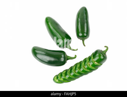 Four Green Jalapeno Peppers One Pepper is Sliced and stacked in Pepper Shape Isolated on White. - Stock Photo