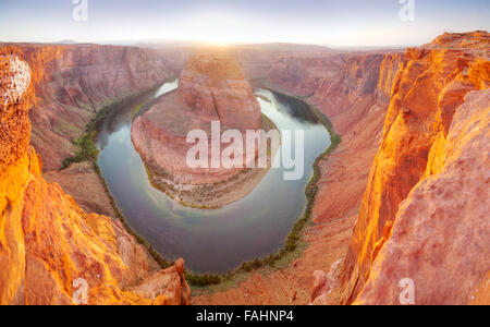 Panoramic overview of Horseshoe Bend near Page, Arizona at sunset - Stock Photo