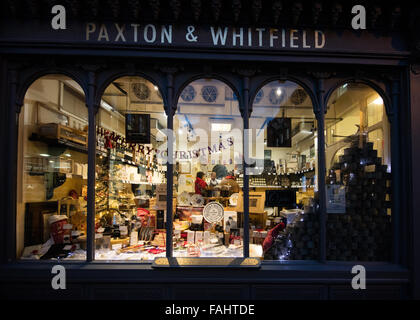 Famous artisan cheese shop in Bath UK with window decorated for Christmas - Stock Photo