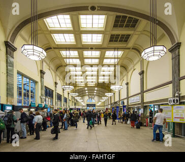 Art Deco interior of Cardiff Central railway station in Wales busy with evening commuters - Stock Photo