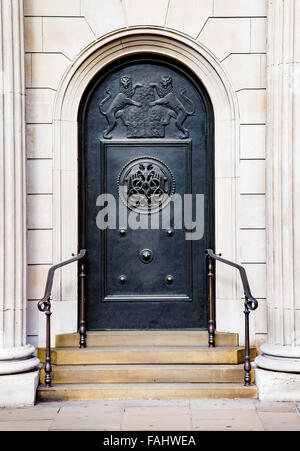 Bronze sculpted side door of the Bank of England building in Threadneedle Street in the City of London UK - Stock Photo