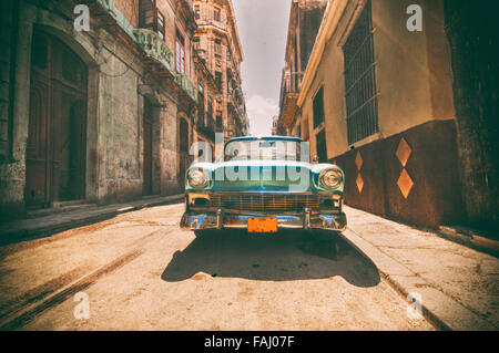 Retro style image with vintage american car parked on a street in Old Havana - Stock Photo