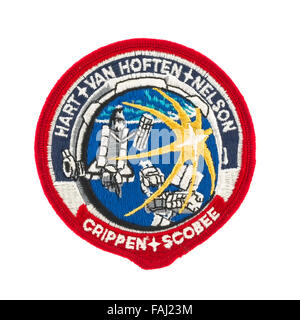 Mission Badge from the STS-41C Space Shuttle Flight on a white background - Stock Photo