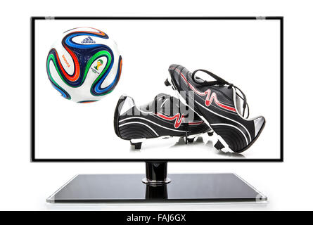 Adidas Brazuca World Cup 2014 Football, The Official Match ball for the 2014 World Cup with football Boots and TV - Stock Photo