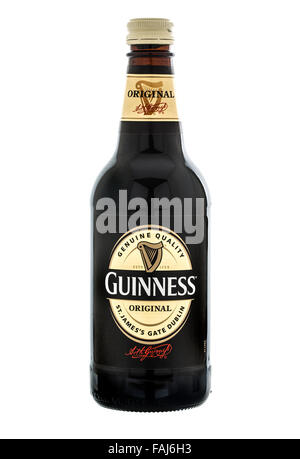 Bottle of Original Guinness on a White Background - Stock Photo