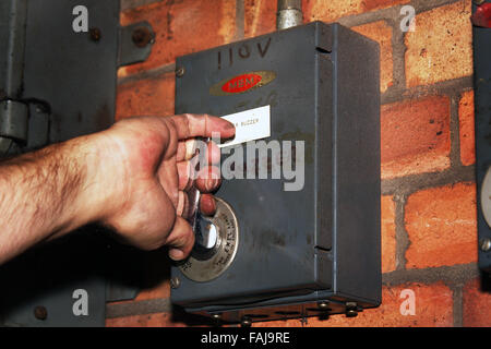 About to operate electrical isolation switch. - Stock Photo