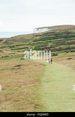 Two people walking on Tennyson Down on the Isle of Wight UK - Stock Photo