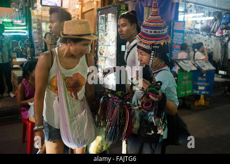 Hill tribe Woman Selling Souvenirs, Khao San Road, Bangkok, Thailand. Khaosan Road or Khao San Road is a short street - Stock Photo