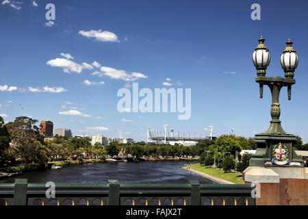 Yarra River and Melbourne Cricket Ground in downtown Melbourne, Victoria, Australia, on a sunny summer day.