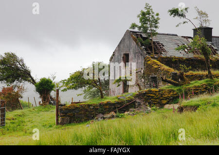Old abandoned cottage in the mountains of Iveragh Peninsula, Co. Kerry,  Ireland - Stock Photo